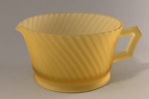 Diana depression glass creamer in frosted amber