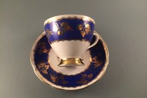 Gladstone China cobalt blue and gold tea cup and saucer side view