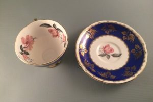 Gladstone China cobalt blue and gold tea cup and saucer with pink magnolia interior top view