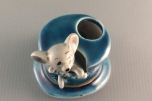Vintage ceramic mouse in a top hat toothpick holder top view